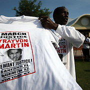 A vendor sells T-Shirts during a rally for the shooting of Trayvon Martin on Thursday,March 22, 2012 at Fort Mellon Park in Sanford, Florida. (AP Photo/Alex Menendez) Trayvon Martin rally in Sanford, Florida.