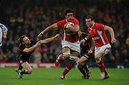 Toby Faletau of Wales © breaks away from Scotland's Mike Blair (l) . RBS Six nations championship 2012, Wales v Scotland at the Millennium Stadium in Cardiff on Sunday 12th Feb 2012.  pic by Andrew Orchard, Andrew Orchard sports photography,