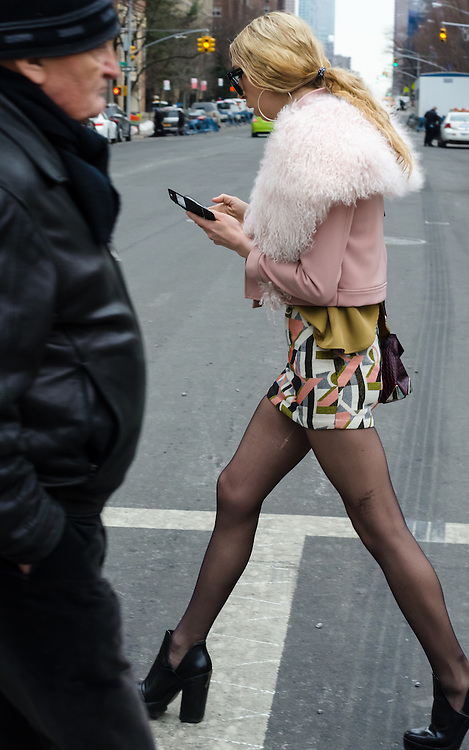 Street Photographs outside Lincoln Center New York for the Mercedes-Benz Fashion Week during February 2015.