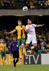 © Licensed to London News Pictures. 11/6/2013. Robbie Kruse and Saeed Murjan go up for a header  during the FIFA World Cup Qualifying match between Australia Vs Jordan at Docklands stadium, Melbourne, Australia.. Photo credit : Asanka Brendon Ratnayake/LNP