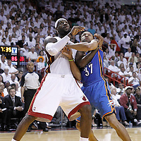 21 June 2012: Miami Heat small forward LeBron James (6) vies for the rebound with Oklahoma City Thunder point guard Derek Fisher (37) during the Miami Heat 121-106 victory over the Oklahoma City Thunder, in Game 5 of the 2012 NBA Finals, at the AmericanAirlinesArena, Miami, Florida, USA. The Miami Heat wins the series 4-1.