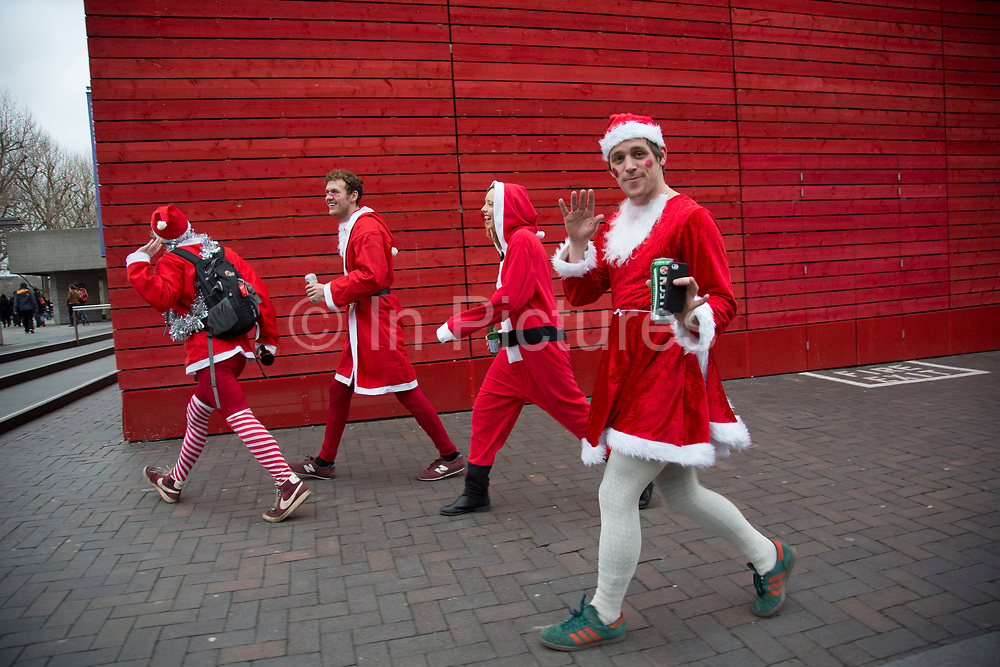Santas arrive to add some festive cheer to the Christmas market. The South Bank is a significant arts and entertainment district, and home to an endless list of activities for Londoners, visitors and tourists alike.