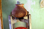 A ceramic drinking water container in a Buddhist temple in Insein in the suburbs of Yangon in Myanmar on 17th May 2016