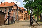 "Brama do KL Auschwitz z napisem ""Arbeit macht frei""<br /> The gate to KL Auschwitz with the inscription ""Arbeit macht frei"""