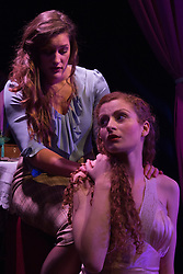 """© Licensed to London News Pictures. 15/01/2014. London, England. L-R: Gemma Stroyan as Emilia and Gillian Saker as Desdemona. The Shakespearean tragedy """"Othello: The Moor of Venice"""" opens at the Riverside Studios in Hammersmith, London in a """"Film Noir"""" setting. Directed by Rebekah Fortune with Stefan Adegbola as Othello and Gillian Saker as Desdemona. Running form 15 January to 18 February 2014. Photo credit: Bettina Strenske/LNP"""