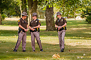 07 SEPTEMBER 2020 - DES MOINES, IOWA: Iowa State Troopers guard the Governor's Mansion in Des Moines during a protest by high school students. The troopers were not wearing face masks or social distancing despite CDC and Des Moines city guidelines calling for masks and social distancing. About 300 Des Moines Public School (DMPS) high school athletes marched through Des Moines to the Governor's Mansion Monday to protest Gov. Kim Reynolds' recent efforts to reopen schools. DMPS, the largest school district in Iowa, is suing to go to online instruction because of the COVID-19 pandemic. The Governor is trying to force the district to reopen with in person instruction. The state ruled that schools using online education can't participate in extracurricular activities, including sports. The student athletes, who all wore face masks to comply with CDC guidelines, were marching to demand the ability to participate in sports despite using online instruction.      PHOTO BY JACK KURTZ