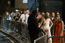 © Licensed to London News Pictures.  19/07/2021. London, UK. Revellers stand in the queue to The Pickle Factory, east London as Lockdown restriction been eased in after midnight and nightclubs are able to greet partygoers after the long break. Photo credit: Marcin Nowak/LNP