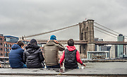 The Brooklyn Bridge is a hybrid cable-stayed/suspension bridge in New York City, spanning the East River between Manhattan Island and Brooklyn on Long Island.