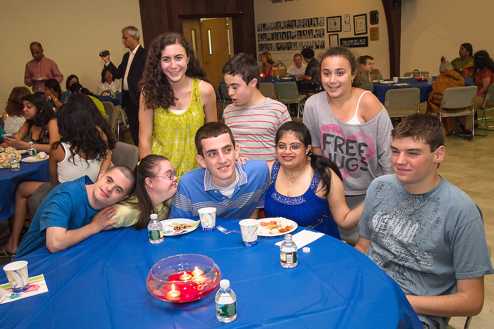 Lincroft, New Jersey: At her high school graduation party, Hema Ramaswamy poses with members of her special education class, including prom date Justin Haggan (to her left) on June 16, 2011.