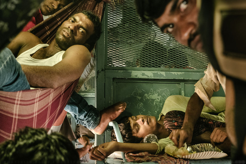 A tangle of sleeping bodies and folded limbs crowd the second class compartment from floor to ceiling.<br /> Inside the Dibrugarh-Kanyakumari Vivek Express, the longest train route in the Indian Subcontinent. It joins Kanyakumari, Tamil Nadu, which is the southernmost tip of mainland India to Dibrugarh in Assam province, near the border with Burma.