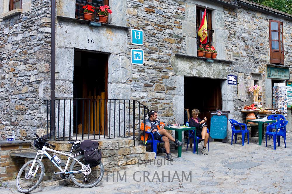Pilgrims at hotel on the Camiino de Santiago pilgrim route at Triacastela in Galicia, Spain