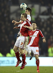 Middlesbrough's Grant Leadbitter and Derby County's Craig Bryson challenge - Photo mandatory by-line: Robbie Stephenson/JMP - Mobile: 07966 386802 - 17/03/2015 - SPORT - Football - Derby - iPro Stadium - Derby County v Middlesbrough - Sky Bet Championship