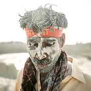 """Pilgrims circumnavigating one of the volcano. Most pilgrims apply the holy volcanic mud to their faces etc. The area around Chandragup (meaning """"Moon Well""""), a sacred site to Hindu of 3 mud volcanoes (mainland Asia's largest ones)."""