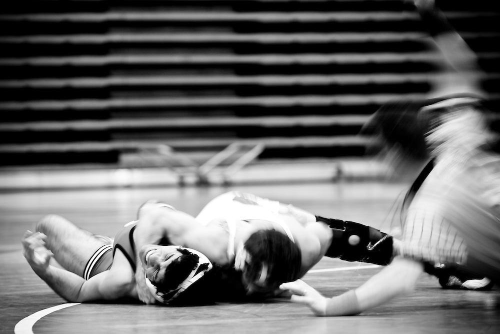 Men's wrestling BU vs Harvard on Feb 11th, 2011. Referee take counts.