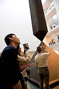 "people in the museum of Modern Art New York photographing the art works. Sculpture ""Broken Obelisk,"" by Barnett Newman,  1964."