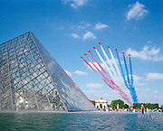 Ending France's Bastille Day parade, the elite 'Red Arrows', Britain's prestigious Royal Air Force aerobatic team, streak over the pyramid peak of the Louvre art museum in the centre of Paris. Leaving vapour trails of red, white and blue smoke to mark the 100th anniversary of the Anglo-French Entente Cordiale. They were chosen by the French authorities to close the fly-pasts. British armed forces paraded in the historic parade for the first time. Under blue skies on a perfect summer day, the squadron lined up in their classic fly-past 'V-shape' called 'Big Battle', following the straight line of the Champs Elysees then eastwards over the Parisian suburbs. Personnel from four British military units were present and French Air Force jets performed their own fly-past to open the parade, while the British Hawk jets of the Red Arrows had the honour of completing it. .
