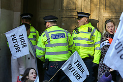© Licensed to London News Pictures. 02/12/2019. London, UK. Police officers guard the entrance to Brexit Party headquarters in Westminster as mothers from climate change campaign group, Extinction Rebellion, stage a breast-feeding protest ahead of the UK General Election. The campaigners are demanding action on behalf of babies and children affected by the climate and ecological emergency. It is the first event of a wider Extinction Rebellion pre-Christmas protests, '12 Days of Crisis'. Photo credit: Dinendra Haria/LNP