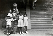 father with children posing during a trip Japan