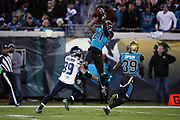 Jacksonville Jaguars free safety Tashaun Gipson (39) and Seattle Seahawks wide receiver Doug Baldwin (89) look on as Jacksonville Jaguars cornerback A.J. Bouye (21) leaps and intercepts a third quarter pass that gives the Jaguars the ball at their own 2 yard line during the 2017 NFL week 14 regular season football game against the Seattle Seahawks, Sunday, Dec. 10, 2017 in Jacksonville, Fla. The Jaguars won the game 30-24. (©Paul Anthony Spinelli)