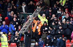 Vitality Stadium staff carry a ladder through the stands after fixing a fluorescent strip light that came loose after being hit by a football during the Premier League match at the Vitality Stadium, Bournemouth.