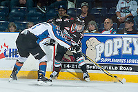 KELOWNA, CANADA - DECEMBER 2: Tanner Lishchynsky #3 of Kootenay Ice digs for the puck at the boards with Dillon Dube #19 of Kelowna Rockets on December 2, 2015 at Prospera Place in Kelowna, British Columbia, Canada.  (Photo by Marissa Baecker/Shoot the Breeze)  *** Local Caption *** Tanner Lishchynsky; Dillon Dube;