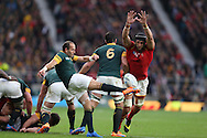 Luke Charteris of Wales blocks the kick from Fourie Du Preez the South Africa captain. Rugby World Cup 2015 quarter final match, South Africa v Wales at Twickenham Stadium in London, England  on Saturday 17th October 2015.<br /> pic by  John Patrick Fletcher, Andrew Orchard sports photography.
