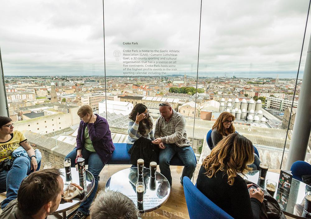 Visitors tasting Guinness at the Gravity Bar atop the Guinness Storehouse, Dublin, Ireland