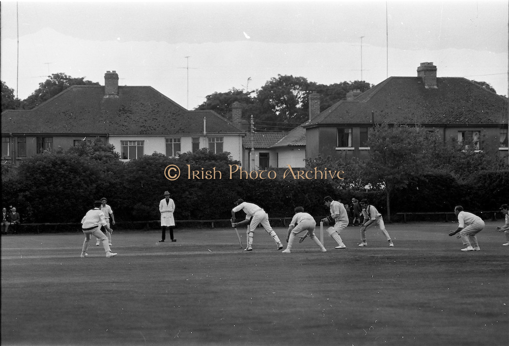 18/07/1970<br /> 07/18/1970<br /> 18 July 1970<br /> Cricket: Clontarf 1st XI v Old Belvedere, Leinster Senior Cup Final at Clontarf Cricket Club, Castle Avenue, Dublin. Frank O'Hanlon (centre), Old Belvedere, batting. Wicket keeper is Fergus Carroll, Clontarf Captain.