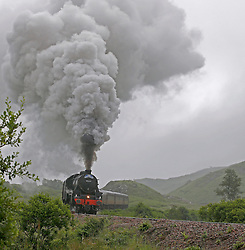 """Also known as the """"Hogwarts Express"""" the Jacobite steam train operates between Fort William and Mallaig on what is often described as the greatest railway journey in the world. Here the Jacobite steam train is seen working hard on the ascent from Glenfinnan.  (c) Stephen Lawson   Edinburgh Elite media"""