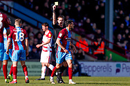 Scunthorpe United midfielder Levi Sutton (22) receives a yellow card during the EFL Sky Bet League 1 match between Scunthorpe United and Doncaster Rovers at Glanford Park, Scunthorpe, England on 23 February 2019.