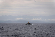 A Greek patrol boat seen shortly after departing the port of Mytilene in Lesbos, Greece. The land across the water is Turkey. This stretch of water has seen hundreds of thousands of refugees and migrants take to unseaworthy vessels on their way to Europe