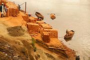 Madagascar, Analamanga region, clay brick production on the river bank near Antananarivo,