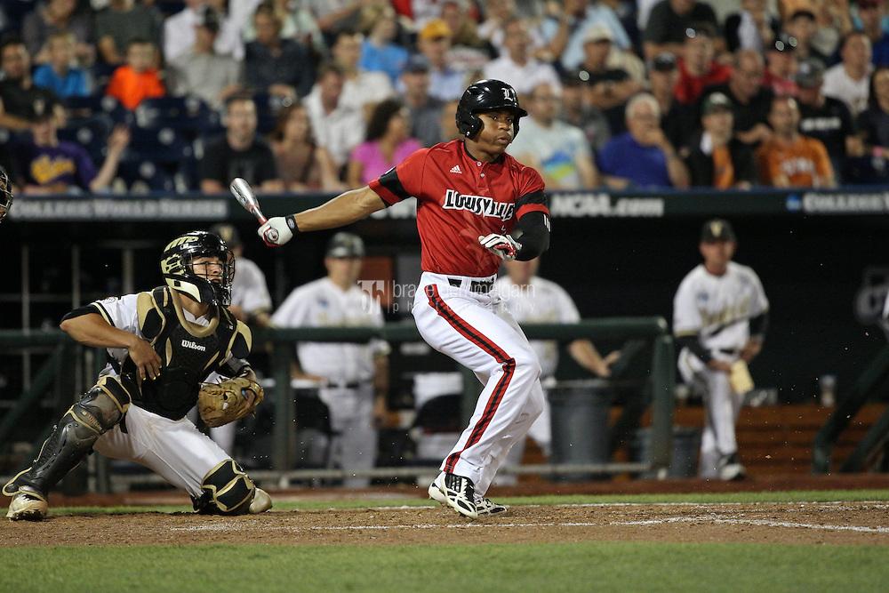 Grant Kay #7 of the Louisville Cardinals bats during Game 2 of the 2014 Men's College World Series between the Vanderbilt Commodores and Louisville Cardinals at TD Ameritrade Park on June 14, 2014 in Omaha, Nebraska. (Brace Hemmelgarn)