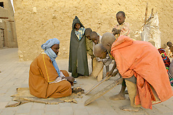 Children memorize the Koran on tablets in the early morning chill at a Koranic School in Timbuktu, Mali March 11, 2007.