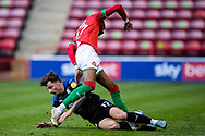 Emmanuel Osadebe of Walsall  battles for possession with Otis Khan of Tranmere Rovers during the EFL Sky Bet League 2 match between Walsall and Tranmere Rovers at the Banks's Stadium, Walsall, England on 13 April 2021.