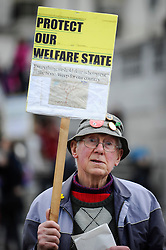 © Licensed to London News Pictures. 01/05/2018. LONDON, UK.  A demonstrator takes part in the annual May Day Rally on International Workers' Day, having marched through central London to a rally in Trafalgar Square.  Photo credit: Stephen Chung/LNP