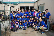 Volunteers from Ark Baptist Church in Milpitas pose for a portrait during the Earth Day clean up activities at Zanker Elementary School in Milpitas, California, on April 24, 2016. (Stan Olszewski/SOSKIphoto)