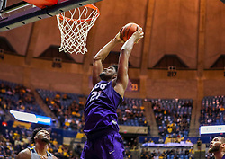 Jan 14, 2020; Morgantown, West Virginia, USA; TCU Horned Frogs center Kevin Samuel (21) dunks the ball during the first half against the West Virginia Mountaineers at WVU Coliseum. Mandatory Credit: Ben Queen-USA TODAY Sports
