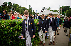 © Licensed to London News Pictures. 28/06/2017. London, UK. Spectators in rowing club colours attend day one of the Henley Royal Regatta, set on the River Thames by the town of Henley-on-Thames in England.  Established in 1839, the five day international rowing event, raced over a course of 2,112 meters (1 mile 550 yards), is considered an important part of the English social season. Photo credit: Ben Cawthra/LNP