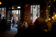 Evening drinkers in the traditionally Victorian Salisbury pub on St Martin's Lane in the West End's Theatreland.