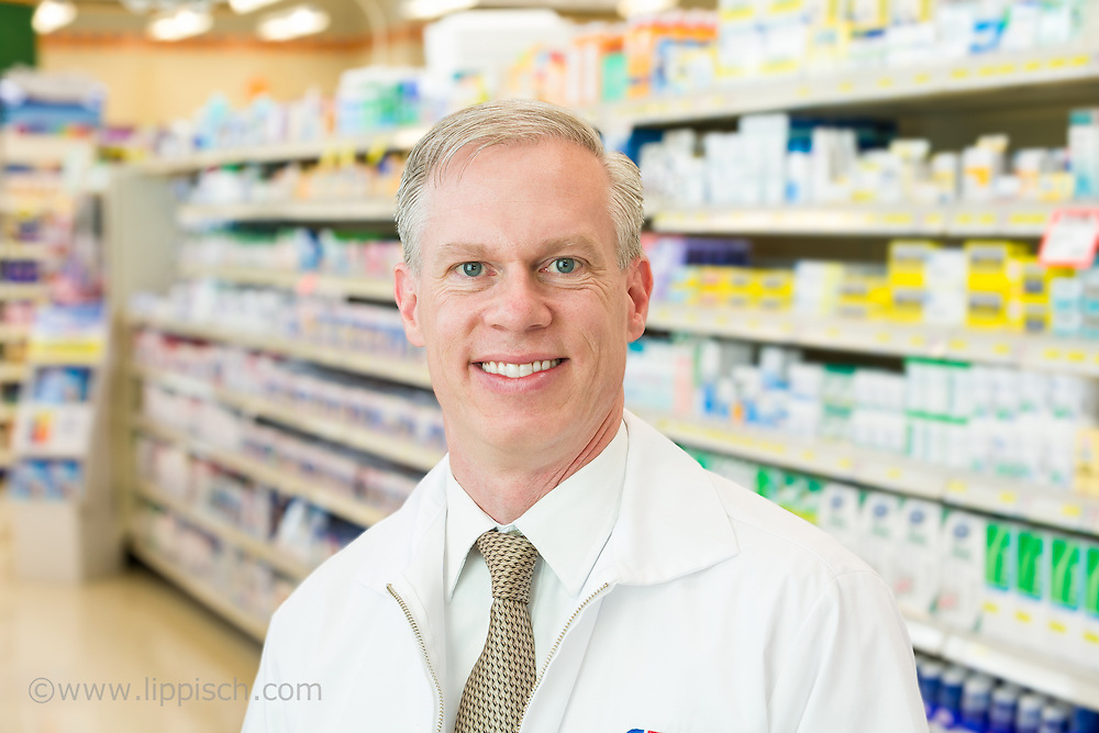 A medical professional photographed on location in a drugstore.
