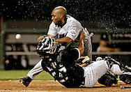 Minnesota Twins' Torii Hunter, left, collides with Chicago White Sox catcher Jamie Burke, knocking the ball loose and scoring on a sacrifice fly hit by Henry Blanco during the eighth inning on July 26, 2004 in Chicago.