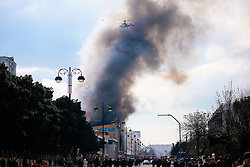 March 26, 2019 - Azerbaijan - A helicopter prepares to drop water on a fire at Diqlas market in Baku, Azerbaijan, Tuesday, March 26, 2019. A large fire broke out this morning in the shopping center ''Diglas'' in the village of 8 kilometer in Baku. Burn the upper floors of the five-story building. (Credit Image: © Aziz Karimov/Pacific Press via ZUMA Wire)
