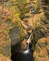 This is the biggest and last waterfall on Skillet Creek as it flows through Pewit's Nest State Natural Area. The fall colors were at their peak and the orange leaves were contrasting with the green moss on the sandstone walls. This deep and narrow gorge is located just outside of Baraboo, Wisconsin.