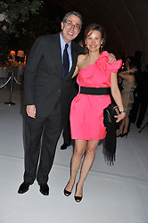 MR & MRS ARNAUD de PUYFONTAINE at a dinner hosted by Cartier following the following the opening of the Chelsea Flower Show 2012 held at Battersea Power Station, London on 21st May 2012.