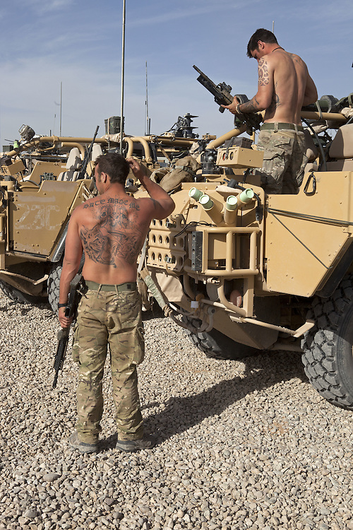 Member of 16 Air Assault Bde's BRF ( Brigade Reconnaissance Force) clean their weapons after returning form and operation. The BRF specialises in reconnaissance and strike operations behind enemy lines. Traveling in all terrain vehicles such as Jackals and on occasions Warthogs the unit travels with all the supplies such as food, water and ammunition required to survive and fight unsupported for extended periods of time. Helmand Province, Southern Afghanistan on the 15th of March 2011.