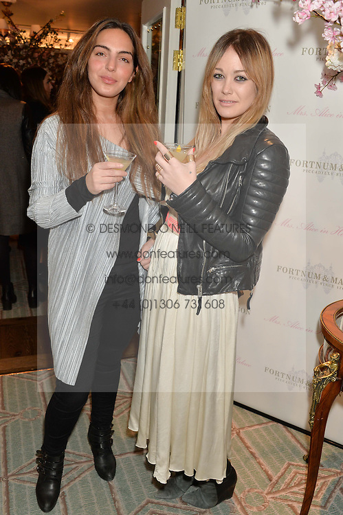 Left to right, ANDREA GELARDIN and ELLIE SHEPHERD at the launch of Mrs Alice in Her Palace - a fashion retail website, held at Fortnum & Mason, Piccadilly, London on 27th March 2014.