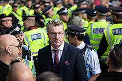 © Licensed to London News Pictures . 27/09/2018 . London , UK . KEVIN CARROLL . Supporters of former EDL leader Tommy Robinson (real name Stephen Yaxley-Lennon ) outside the Old Bailey , as Robinson faces a retrial for Contempt of Court following his actions outside Leeds Crown Court in May 2018 . Robinson was already serving a suspended sentence for the same offence when convicted in May and served time in jail as a consequence , but the newer conviction was quashed by the Court of Appeal and a retrial ordered . Photo credit: Joel Goodman/LNP