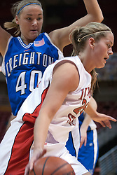 26 February 2006:  Holly Hallstrom drives past Amy Hoffman.......Illinois State Redbirds out muscled the Creighton Bluejays on Senior day by a score of 75-61.  Senior Holly Hallstorm grabbed her 10th double double with 20 points and 12 rebounds.  Competition took place at Redbird Arena on Illinois State University campus in Normal Illinois.