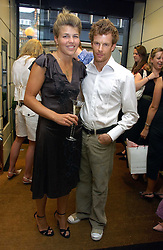 AMBER NUTTALL and TOM AIKENS at a party hosted by Links at their store in Sloane Square, London to celebrate the forthcoming Glorious Goodwood Racing festival held on 26th July 2006.<br /><br />NON EXCLUSIVE - WORLD RIGHTS
